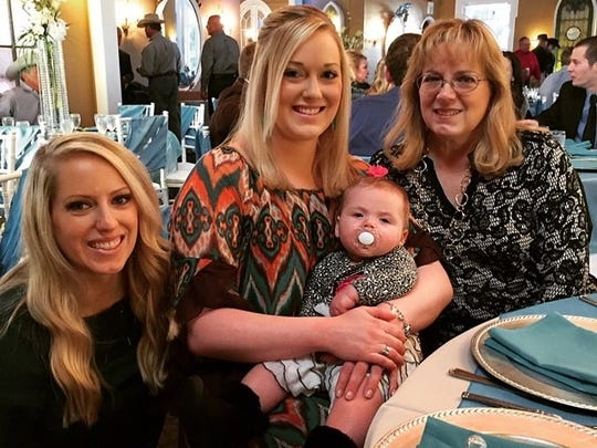 Kristen Webernick, center, with her sister, niece and mother.