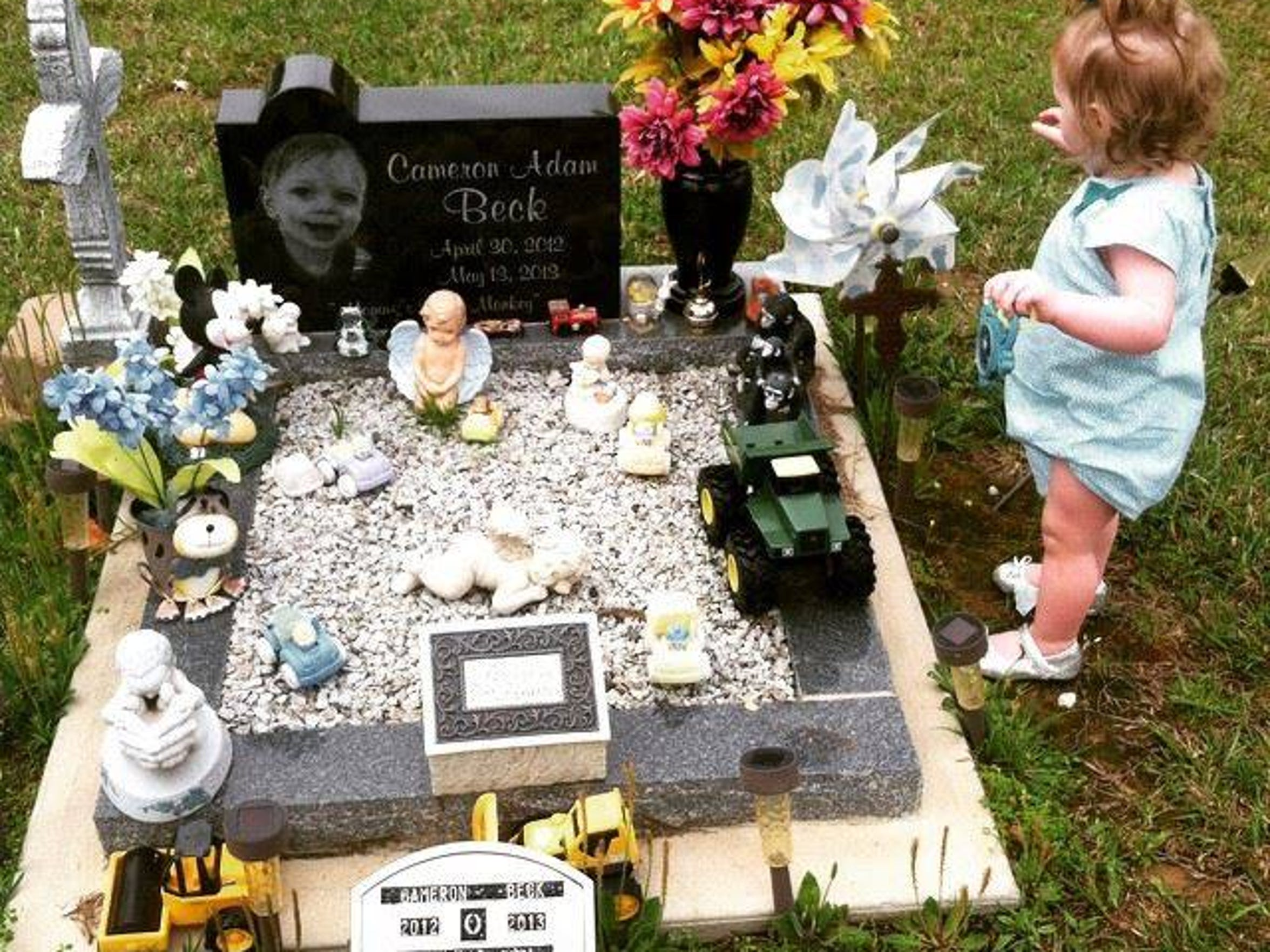 Cameron's sister, Madison Hope, visits his grave.
