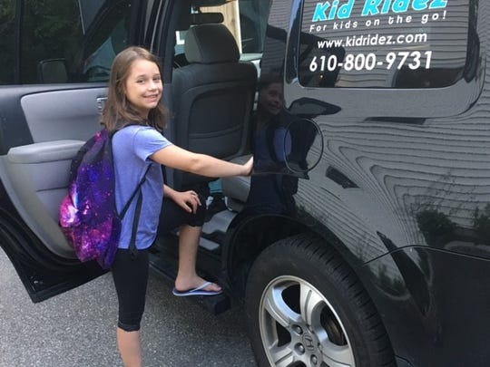 A student is picked up by Kid Ridez, a transportation company that caters to families who can't pick up or drop off their kids at school because of their busy work schedules.