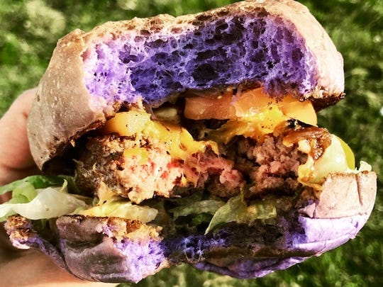 The HAPA Food Truck serves a grass-fed burger on a purple bun made with ube, a violet-hued yam that imparts a subtle sweetness to the brioche.