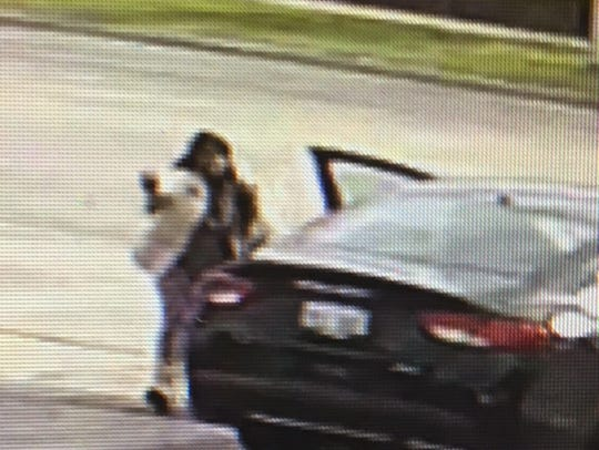 A female suspect who aided a man in a road rage shooting
