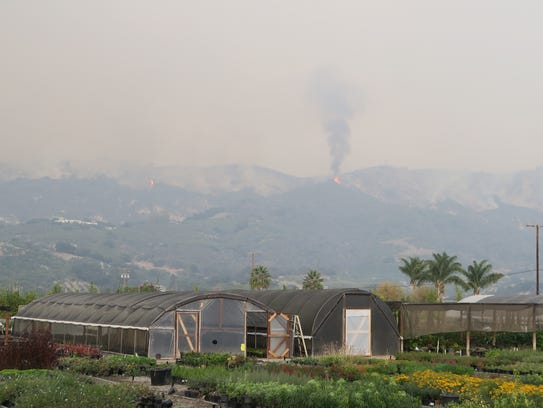 Flames and smoke were visible in the hills behind Carpinteria