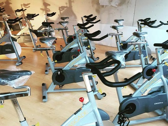 Bikes have been moved into the space at Well.Fit Asheville. The new cycling and fitness studio will open Dec. 15.