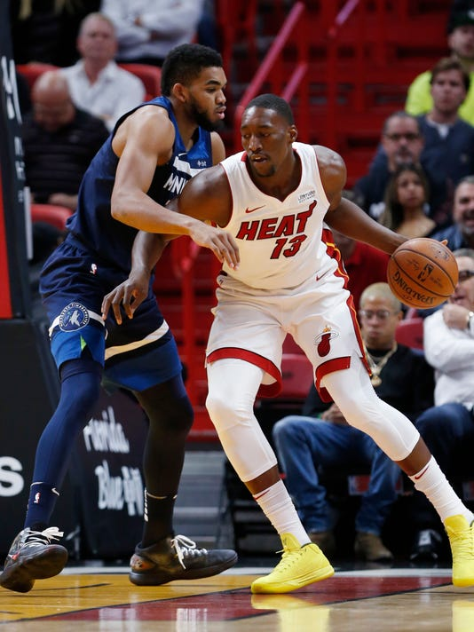 Miami Heat forward Bam Adebayo, right, drives up against Minnesota Timberwolves center Karl-Anthony Towns, left, during the first half of an NBA basketball game, Monday, Oct. 30, 2017, in Miami. (AP Photo/Wilfredo Lee)