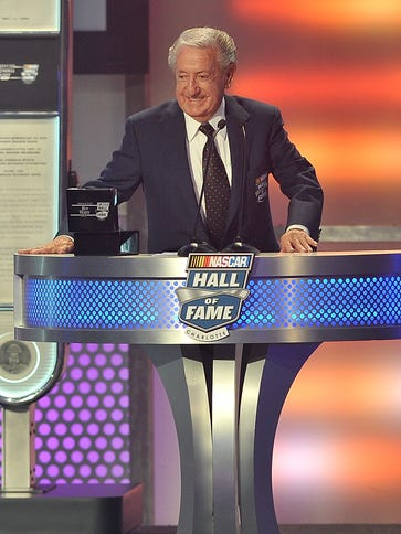 Rex White speaks during his induction to the NASCAR