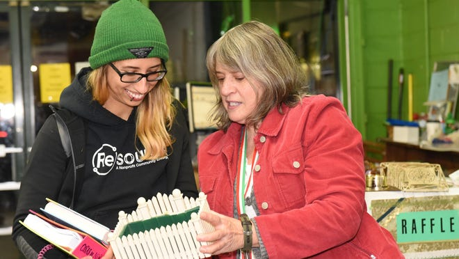 Nia Ivanof of Burlington, acting store manager at ReSource, left, peruses recycled items from Judith Citarella of Burlington, who helps friends reduce their belongings and brings them to ReSource to be redistributed.