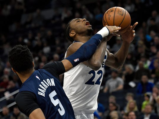 Memphis Grizzlies' Andrew Harrison (5) fouls Minnesota Timberwolves' Andrew Wiggins (22) who was shooting during the first quarter of an NBA basketball game on Monday, March 26, 2018, in Minneapolis. (AP Photo/Hannah Foslien)