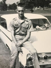 Mark Heavrin poses for a picture before he is deployed to Vietnam.