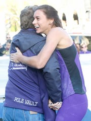Pole vaulter Demi Payne celebrates after clearing the