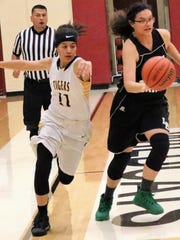 Cloudcroft's Nina Renteria, right, rushes down the court while being pursued by Alamogordo's Jayden Krueger.