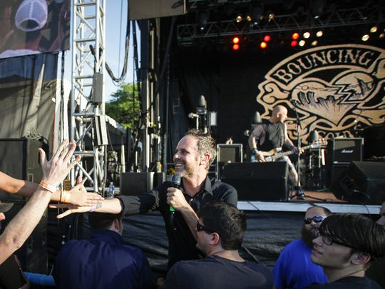 Bouncing Souls frontman Greg Attonito steps offstage to greet his fans on July 6 during the Common Ground Music Festival at Louis Adado Riverfront Park in downtown Lansing.