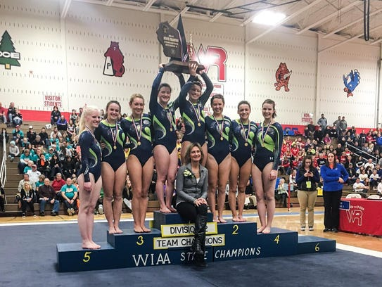 The Whitefish Bay girls gymnastics team celebrates