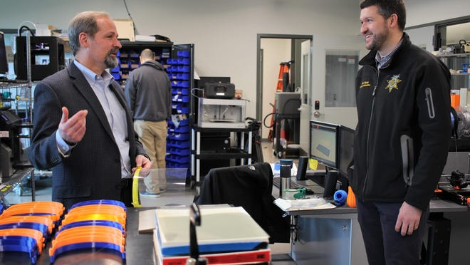 Director of the Hudson Valley Additive Manufacturing Center Dan Freedman, left, and Ulster County Executive Pat Ryan talk about the production of 3-D face shields.