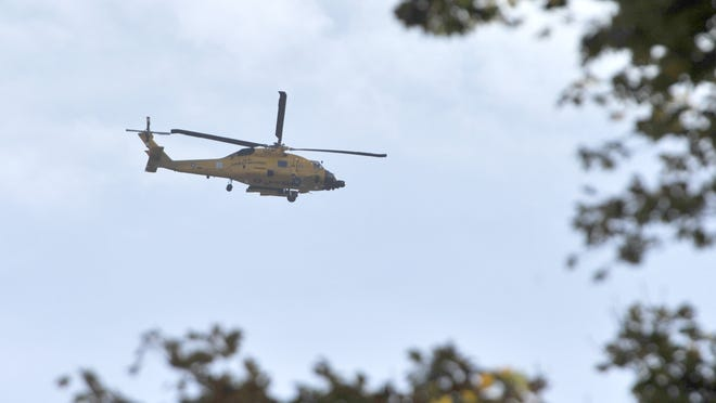 A Coast Guard rescue helicopter heads back to Air Station Cape Cod. Residents of towns neighboring Joint Base Cape Cod have questioned a perceived increase in aircraft activity of late.