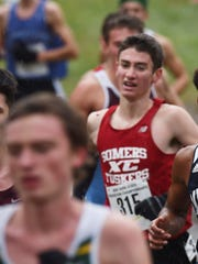 Somers' Greg Fusco, center, heads into the home stretch