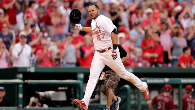 St. Louis Cardinals' Jhonny Peralta tosses his helmet as he rounds the bases after hitting a walk-off solo home run during the 10th inning of a baseball game against the Arizona Diamondbacks Monday, May 25, 2015, in St. Louis. The Cardinals won 3-2.