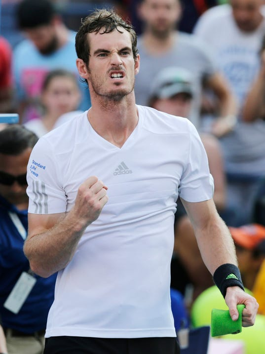 Andy Murray, of the United Kingdom, reacts after defeating Jo-Wilfried Tsonga, of France, during the fourth round of the 2014 U.S. Open tennis tournament, Monday, Sept. 1, 2014, in New York. (AP Photo/Charles Krupa)