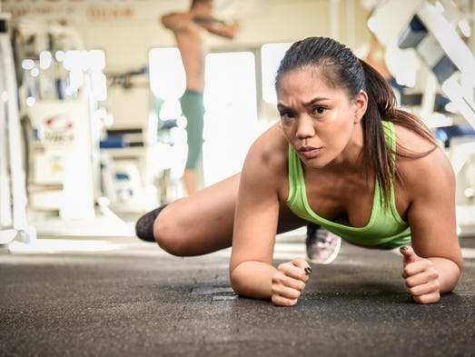Crystal Borrego works her core with plank fire hydrants
