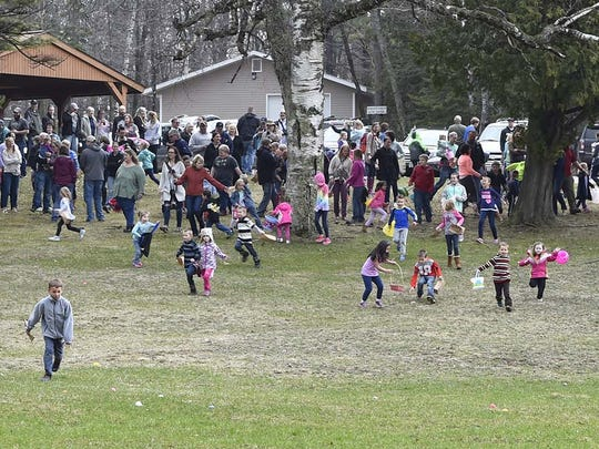 The egg rush is on as Easter egg hunters take off in pursuit of plastic, candy-filled eggs at last year's hunt in Fitzgerald Park in Ellison Bay.