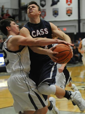 Knight guard Jacob Page breaks up Ryan Bixler's fast break attempt drawing an intentional foul Friday night in Hooser Conference tournament play.