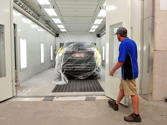 The Flawless Auto Body shop's paint curing room which uses the Revo system to cure their paint in a matter of minutes .