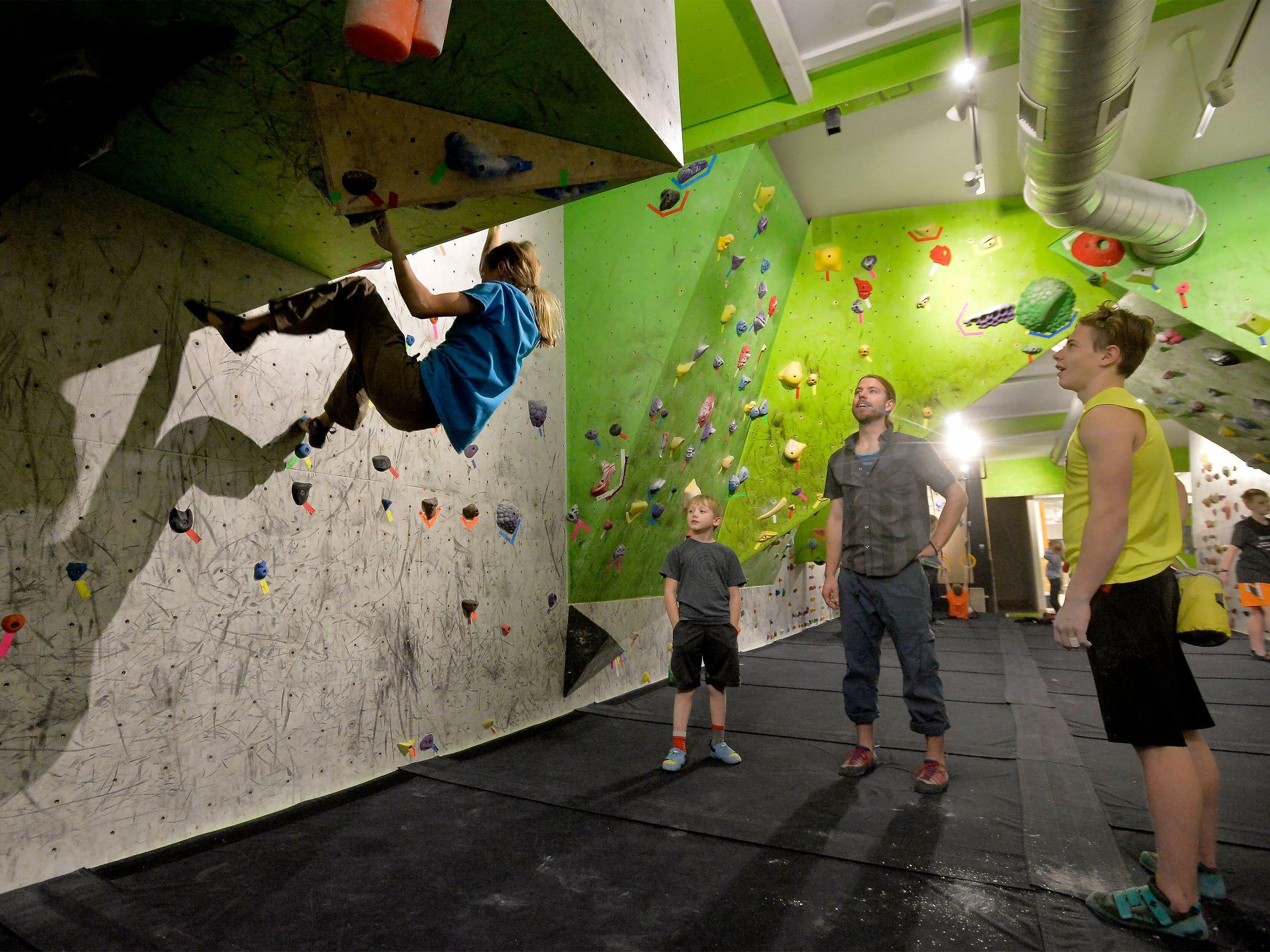 Christian Buhler, age 13, watches Hi-Line Climbing teammate, Layla Kerr, practice at Hi-Line Climbing Center.