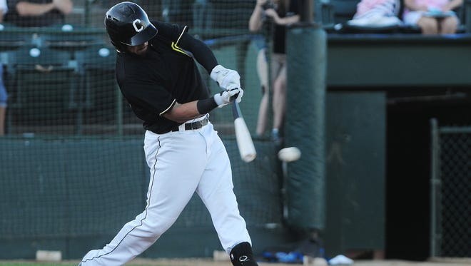 The Canaries' David Bergin (13) hits a single during a game against St. Paul on July 15.  The first baseman hit .331 with 65 RBI and 15 home runs last season with the Canaries.