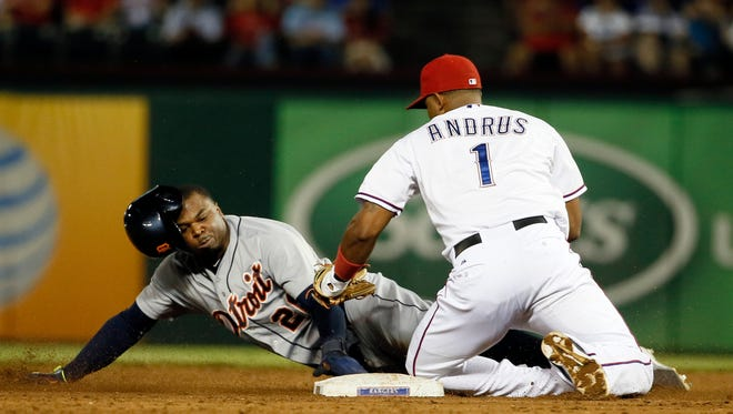 Tigers leftfielder Rajai Davis is tagged out trying to steal second by Rangers shortstop Elvis Andrus in the second inning of the Tigers' 7-6 loss Tuesday in Arlington, Texas.