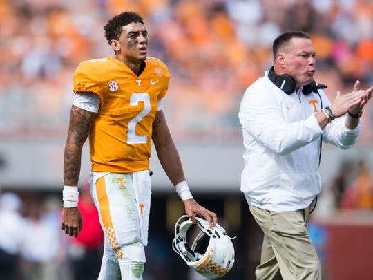Tennessee quarterback Jarrett Guarantano (2) walks off the field lead by Tennessee Head Coach Butch Jones during a Tennessee vs. South Carolina game at Neyland Stadium in Knoxville, Tenn. Saturday, Oct. 14, 2017.