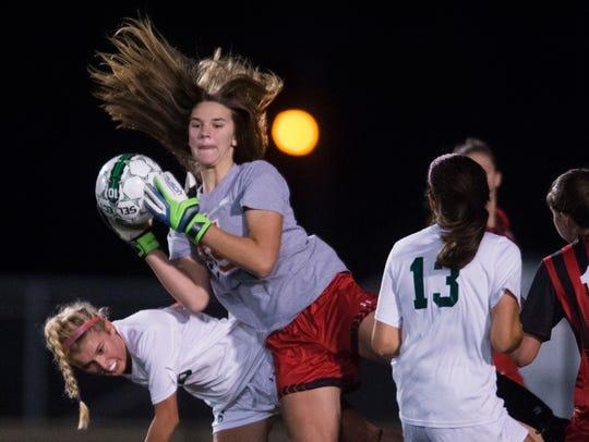Central's goal keeper Ashton Blair makes a save during
