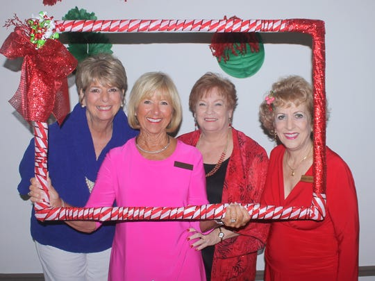 Enjoying the photo frame are Cindy MacQuarrie, Sue Stone, Pam Callinan and Marsha Crawford.