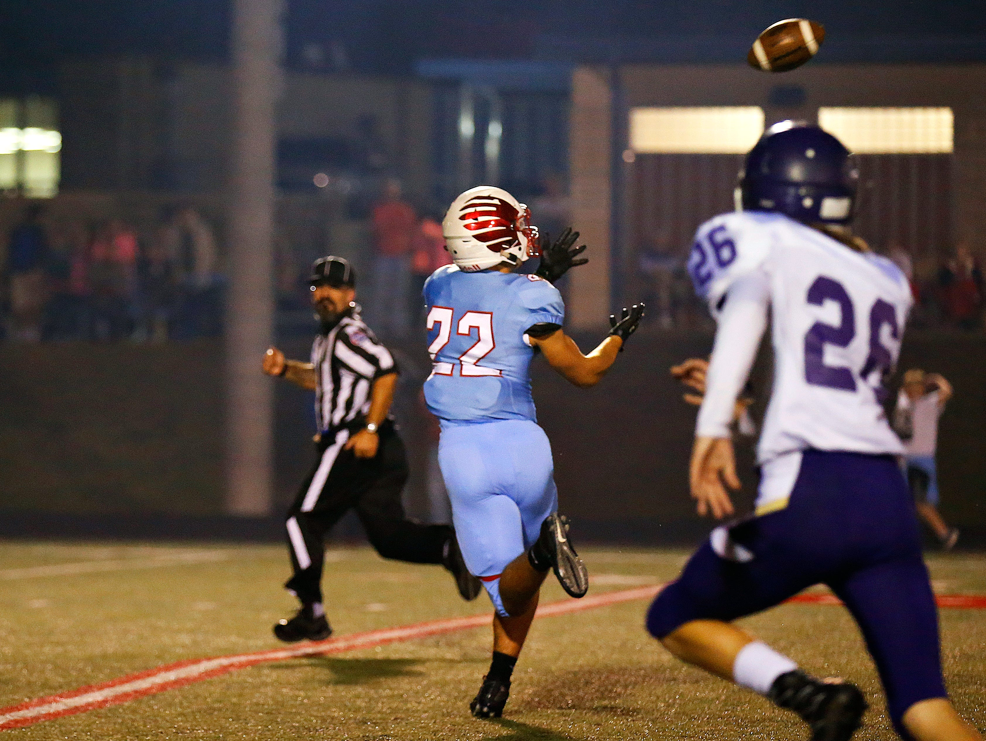 Glendale High School wide receiver Luke Montgomery (22) catches a long touchdown pass by quarterback Alex Houston (not pictured) during first quarter action of the game between Glendale High School and Camdenton High School at Lowe Stadium in Springfield, Mo. on Oct. 14, 2016. The Glendale Falcons won the game 63-35.