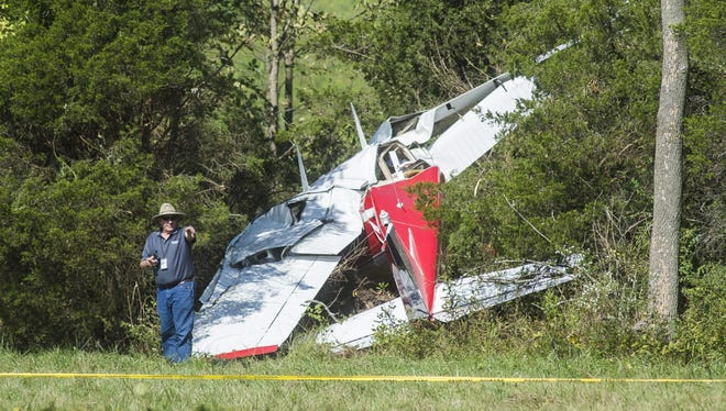 An investigator from the Federal Aviation Administration works at the scene of a plane crash Saturday Sept. 19, 2015 in Cumberland Township near Black Horse Tavern Road.