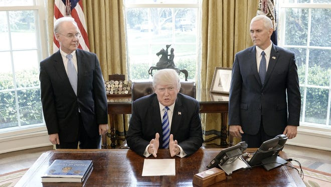 President Trump with HHS Secretary Tom Price and Vice President Pence after Obamacare repeal bill was pulled from the House floor, Washington, March 24, 2017.