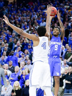 Kentucky's Malik Monk (5) hits the game-winning 3-pointer in a 103-100 win against North Carolina on Saturday.