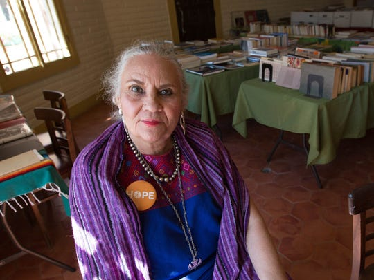 Denise Chavez, author and owner of Casa Camino Real Bookstore, sits for a portrait in her pop-up book and art sale in what was Patina Home, Friday May 18, 2018.