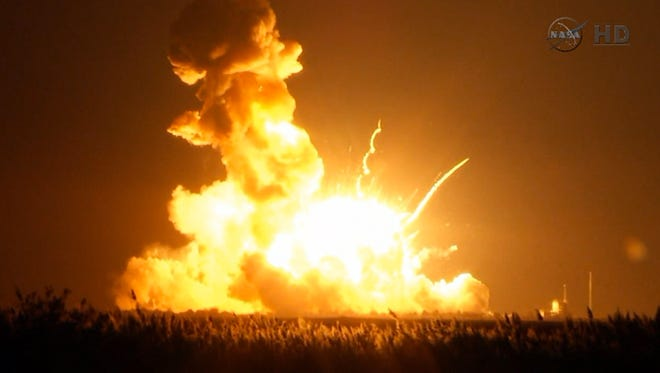 This image taken from video provided by NASA TV shows Orbital Sciences Corp.'s unmanned rocket blowing up over the launch complex at Wallops Island, Va., just six seconds after liftoff. The company says no one was believed to be hurt and the damage appeared to be limited to the facilities. (AP Photo/NASA TV)
