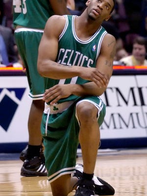 In this April 16, 2006 file photo, Boston Celtics' Orien Greene reacts after he fell and lost the ball during an NBA basketball game against the New Jersey Nets in East Rutherford, N.J.  Greene  has been arrested after being accused of breaking into two Florida homes and fondling a woman. News outlets report Greene was taken into custody Monday, Jan. 9, 2017 on battery and burglary charges.