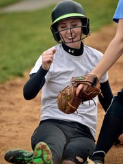 Emily Wenner slides at home during softball practice Monday, March 6, 2017 at Shippensburg High School. Monday was the first day of practice for spring teams in Franklin County.