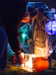 Ed Smith, grandfather of Jaden Laws, lights candles