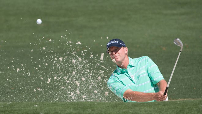 Steve Stricker hits out of the bunker during a Masters practice round on Tuesday.