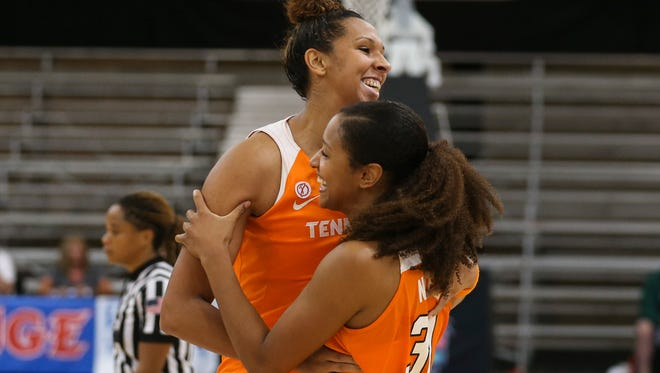 Tennessee's Mercedes Russell, left, and Jaime Nared celebrate the Lady Vols' 101-99 overtime victory over Marquette last Thanksgiving at the Cancun (Mexico) Challenge. Russell and Nared likely will be selected Thursday night in the WNBA draft.