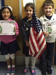 In Honor of Veteran's Day on Nov. 11, Linden School No. 2 students in Ms. Jackson's class showed their support for our troops by writing a friendly letter.  Students left to right: Lucia Lopez, Ivy Crespo, and Vincent Medina.