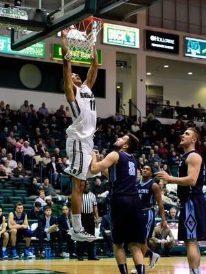 Binghamton's Romello Walker slam-dunks the ball during Saturday's men's basketball game at the Event Center.