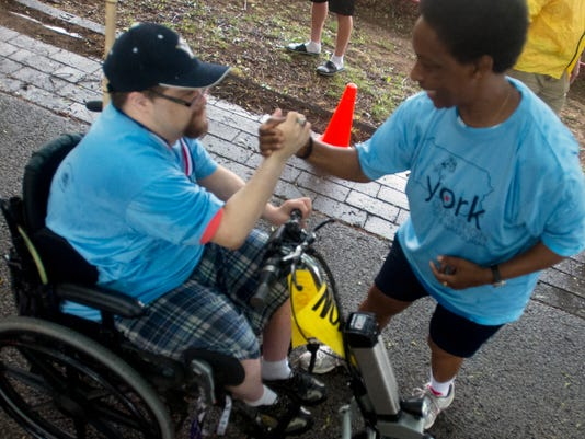 Loretta Claiborne, right, congratulates Noah Rinehart coming through the finish during the York Marathon in May.