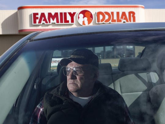 """Raymond Eldridge waits in the car while his wife shops Thursday, Nov. 10, 2016, in Corinth, Maine. Eldridge voted Trump but didn't see too much of a choice. """"I didn't vote for Hillary Clinton because she's a woman and I can't see a woman as president,"""" he said. (AP Photo/Robert F. Bukaty)"""