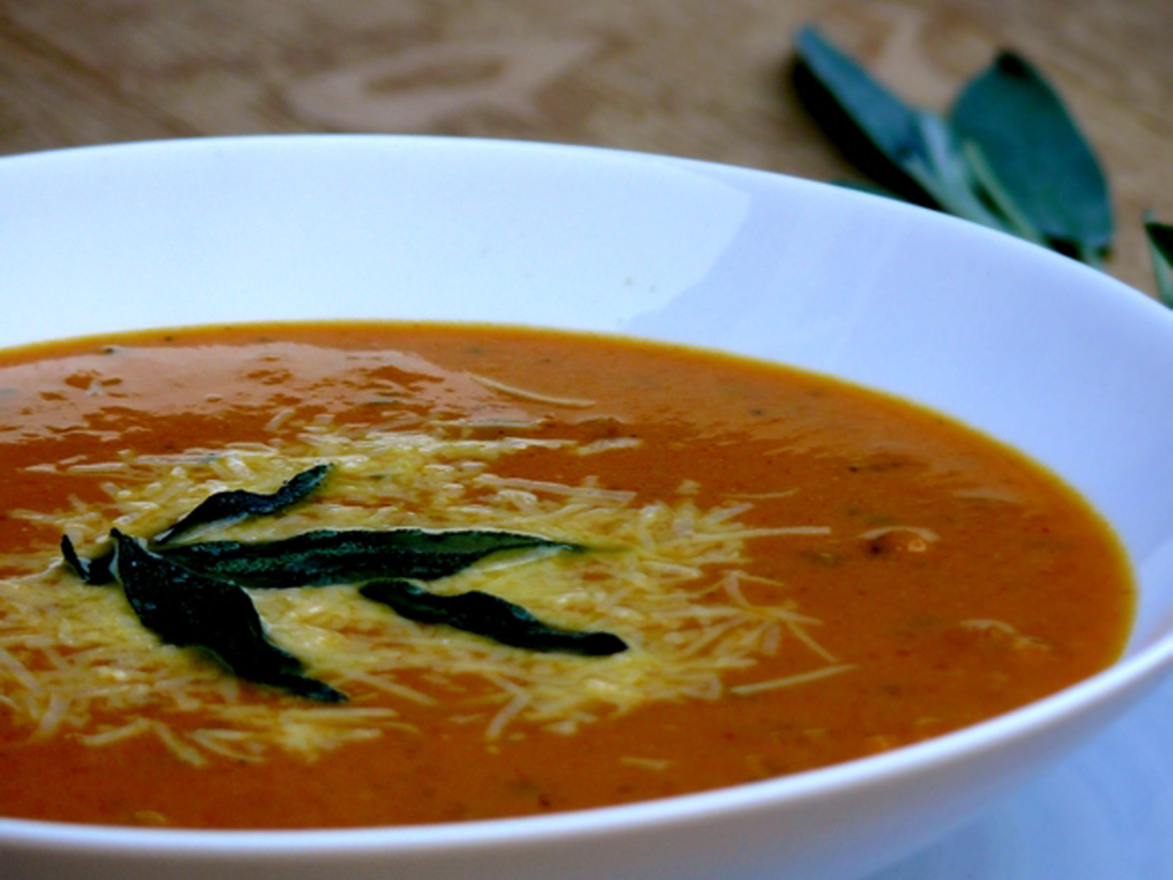 Tangy Sriracha Pumpkin-Parmesan Soup with Fried Sage Leaves