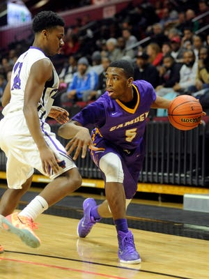 Rasool Hinson (5) of Camden looks to pass as Tarae Merritt of Newark Tech defends in the first quarter of the Group 2 state final at Rutgers Athletic Center.