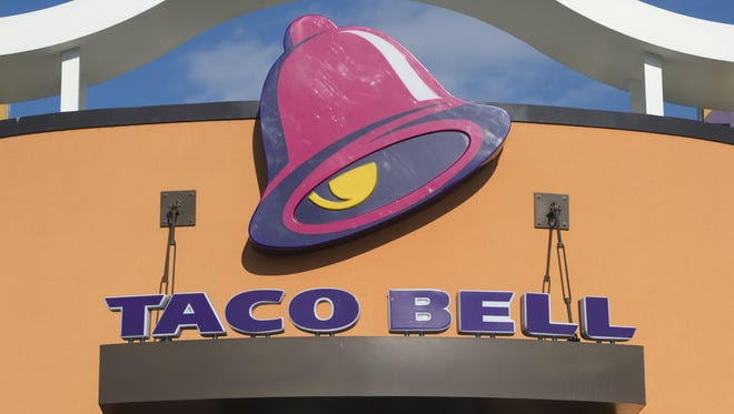 A Taco Bell fast food restaurant is seen in New Carrollton, Maryland, December 31, 2014. AFP PHOTO / SAUL LOEB        (Photo credit should read SAUL LOEB/AFP/Getty Images)