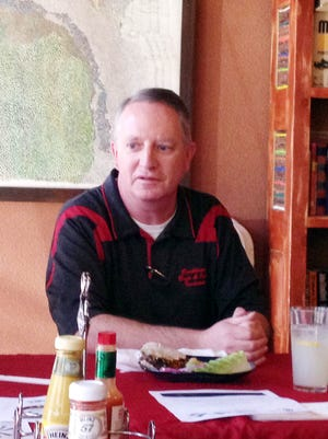Athletic Trainer Michael McMillan discusses his work at Tuesday's meeting of the Silver City Kiwanis Club.